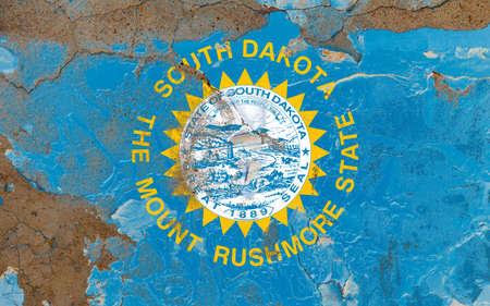 South Dakota grunge, damaged, scratch, old style state USA flag on wall.
