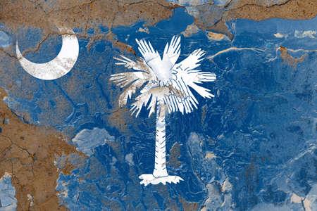 South Carolina grunge, damaged, scratch, old style state USA flag on wall.