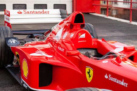 Novosibirsk, Russia - 11.01.2019: Red Ferrari racing sports cars for Formula 1 on the street near the garage box. Redakční