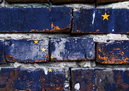 Alaska grunge, damaged, scratch, old style united states flag on brick wall.