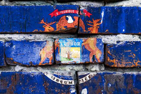 Michigan grunge, damaged, scratch, old style united states flag on brick wall. Banco de Imagens