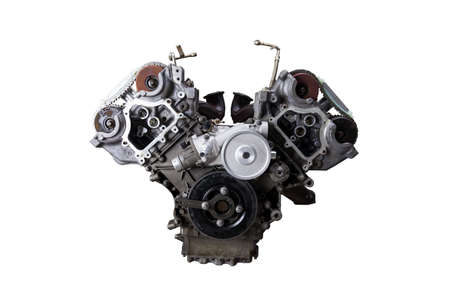 V-shaped engine with six or eight cylinders made of aluminum and metal during repair or replacement on a guarantee on a white isolated background.