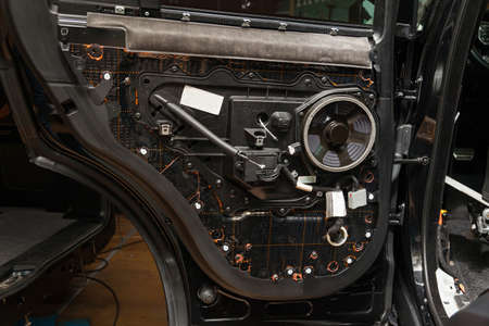Tuning the car with three layers of noise insulation on the doors. Audio and vibration isolation. Dismantled car. Installation of audio speakers
