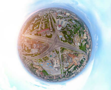 Aerial view of the city with traffic, streets and buildings with green trees and rails under the blue sky with clouds at summer day in Novosibirsk, Frunze. Panoramic 360 degrees of the panet.