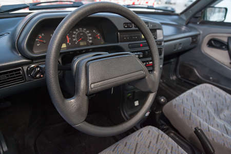 Novosibirsk, Russia - 12.27.2019: The interior of the car lada 2114 samara with a view of the steering wheel, dashboard, seats and multimedia system with light gray trim. Auto service industry.