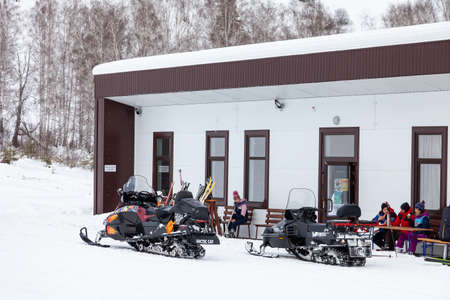 Altai, Russia - 01.01.2020: Snowmobiles near the building for the rental of ski equipment in the Altai Mountains