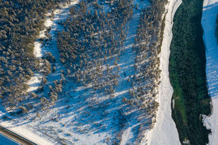 Picturesque aerial view in the Altai mountains under a blue sky with clouds in winter with green river Katun. White snow and calm. Reklamní fotografie