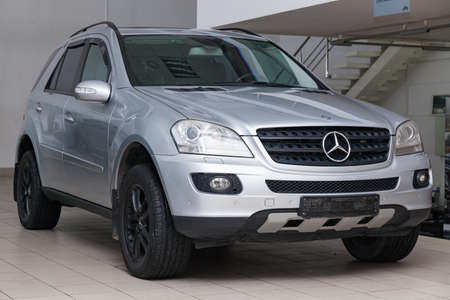 Novosibirsk, Russia - 08.01.2018: Silver Mercedes Benz ML350 M-class 2007 year front view with dark gray interior in excellent condition in a dealership with white walls Editöryel