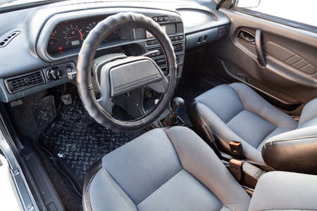 Novosibirsk, Russia - 02.01.2020: The interior of the car lada 2114 samara with a view of the steering wheel, dashboard, seats and multimedia system with light gray trim. Auto service industry. Standard-Bild - 139191846