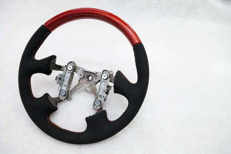 The disassembled steering part before installation of the equipment is a carbon alutex fibre orange wheel with soft genuine leather and tuning, stitched with a contrast thread. Foto de archivo