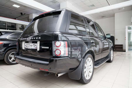 Novosibirsk, Russia - 02.07.2020: Black used Land Rover Range Rover Supercharger 2010 with rear view on the car snow parking after preparing for sale Editorial