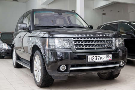 Novosibirsk, Russia - 02.07.2020: Black used Land Rover Range Rover Supercharger 2010 with front view on the car snow parking after preparing for sale