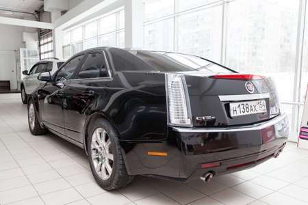 Novosibirsk, Russia - 08.01.2018: Rear view of Cadillac CTS in black color after cleaning before sale in a sunny day and on parking in dealership Editorial