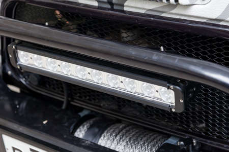 Horizontal LED lamp for lighting in difficult weather conditions on a car prepared for off-road and rally. Stockfoto