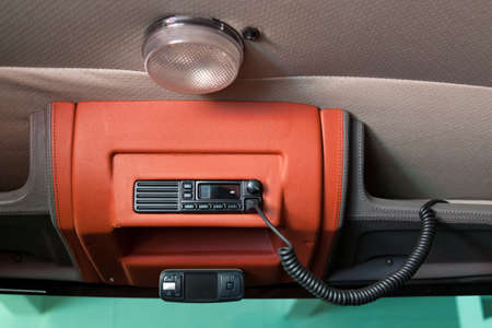 Mobile walkie-talkie on the ceiling of a truck with a microphone and a radio station for communication with emergency police, ambulance and firefighters.