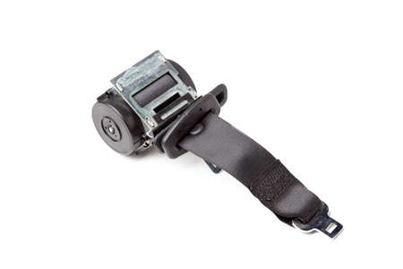 Spare part and interior element black seat belt from a car on a white isolated background. Auto service industry.