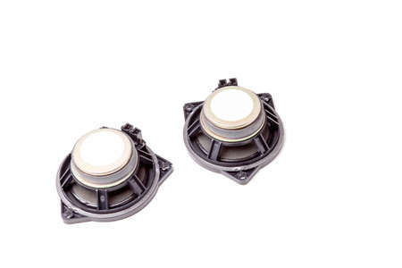 A pair of acoustic rear view loudspeakers are dynamic emitters that produce sound waves due to the vibration of a diffuser membrane. Musical device in tyuneng cars in the workshop. Stock Photo