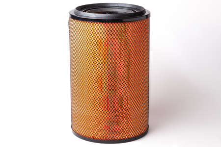 Air filter of a truck to clean the air stream from impurities before feeding it into the cylinders of an internal combustion engine. Spare part for sale or replacement in a garage or workshop. 版權商用圖片