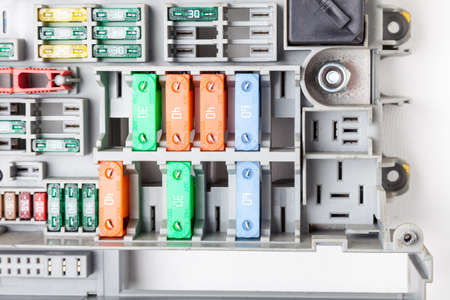 Automotive pin, knife, flat or flag fuses - a protective device opens the electrical circuit when rated current in circuit is exceeded. Panel with holders with color markers for polyamide cases.