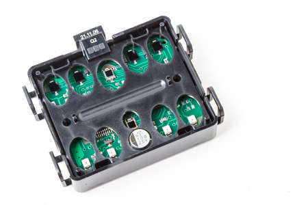Electronic board in a black plastic box with light and rain sensors to automatically turn on lights and wipers during rain or at night. Auto parts catalog. Stockfoto
