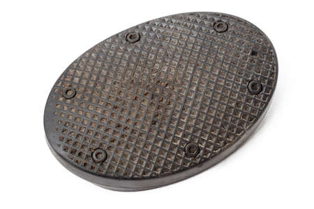 Old rubber brake pedal pad dirty from black rubber on a white isolated background in a photo studio, a spare part for car repair or for sale at junk yard.