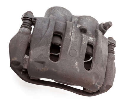 Old metal brake caliper on a white background in a photo studio for replacement during the repair of the chassis or for a catalog of spare parts for sale on auto parsing.
