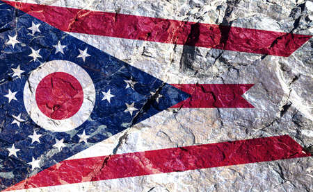 Only the Ohio national flag is non-rectangular and has rules for correct folding for conservation. Drawn on a rocky mountain wall for independence day.