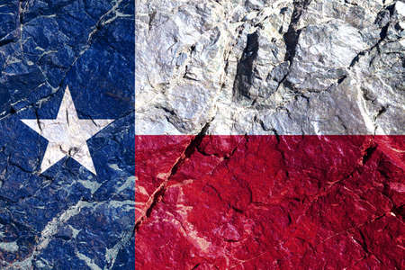 The national flag of the American state of Texas is blue and white with a star painted on the mountain wall on Independence Day. Rock graffiti of climbers during the ascent. Stock Photo