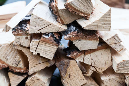 A stack of chopped wood to start a fire before the winter season. Dried wood pallets with textured wood for barbecuing or lighting a fire.