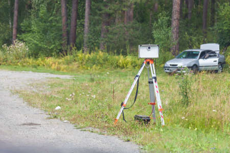 Portable radar camera design on the side of the road to record the speed of vehicles to automatically determine the fine for speeding and violation. Russian gadget in the work of the road police post.