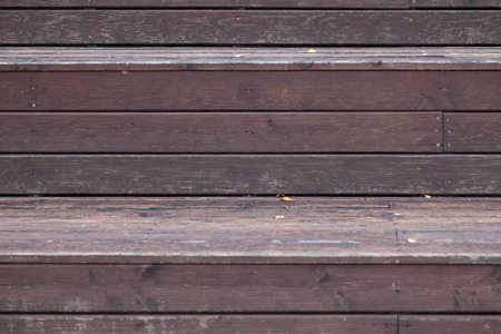 Wooden slats knocked tightly to each other in brown and gray color background for decorative pano or autumn composition. Eco materials for construction and decoration.