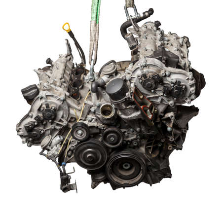 Close Up of V6 engine for the maintenance and repair of a car in a auto service on white isolated background. Vehicle parts catalog.