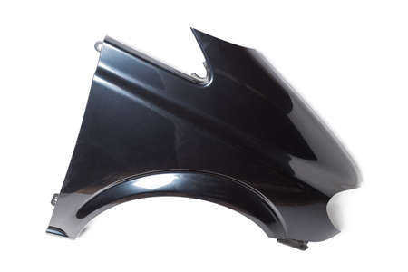 Black plastic fender on a white isolated background in a photo studio for sale or replacement in a car service. Mudguard on auto-parsing for repair or a device to protect the body from dirt. 写真素材