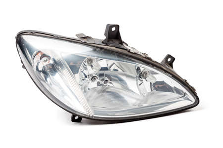 Stylish xenon headlight of a German car - optical equipment with a lamp inside on a white isolated background. Spare part for auto repair in a car workshop.