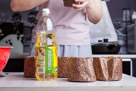 Novosibirsk, Russia - 04.18.2020: Sunflower oil sloboda in a plastic bottle on the table while cooking Easter cakes. 報道画像