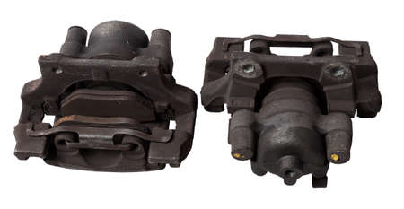 Two old metal brake caliper on a white background in a photo studio for replacement during the repair of the chassis or for a catalog of spare parts for sale on auto parsing.