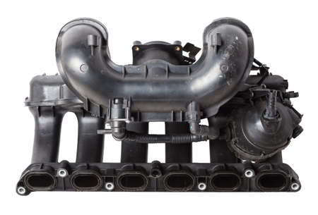 Intake manifold plastic housing with a system for adjusting the air flow to the engine. Repair and replacement of spare parts of vehicles in a car service. 写真素材