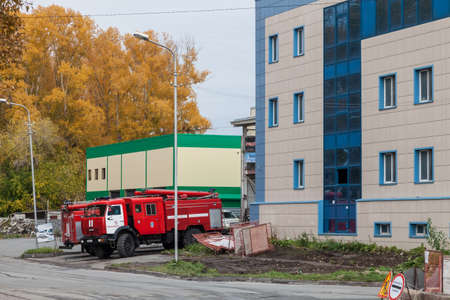 Novosibirsk, Russia - 09.19.2020: Two large red Kamaz brand fire trucks arrived to call to put out a fire in the city. 報道画像