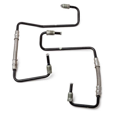 A two metal brake pipes are part of the vehicle's brake system, which supplies brake fluid under pressure to the service brake cylinders or calipers on wheels. Spare parts for sale in auto service. 写真素材