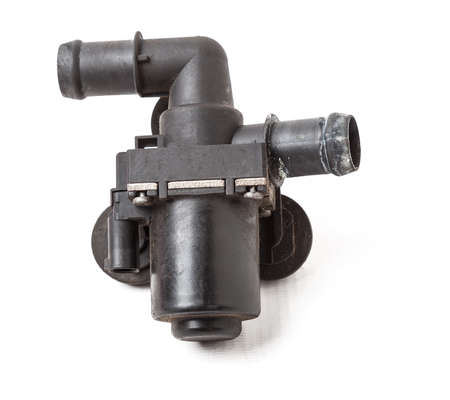 The water pump of the coolant pump is designed to provide forced circulation of antifreeze in the cooling system - from the engine to the radiator and vice versa. Black plastic spare part for sale. 写真素材