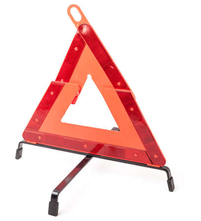 Warning stop sign made of red reflective plastic with a blue case on a white isolated background in a photo studio. Mandatory device for being in the car. Spare part for sale on auto parsing.