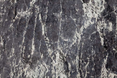 Background and texture of stone from an ancient rock with different patterns for design and geology. Stock fotó
