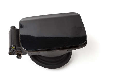 Detail of a black car body with rubber seal on a white isolated background in a photo studio gas tank cover spare part for sale at a car service or at an auto-parsing.