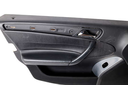 Car door trim with black leather upholstery on a white isolated background for repair and replacement in a car service. Spare parts catalog.