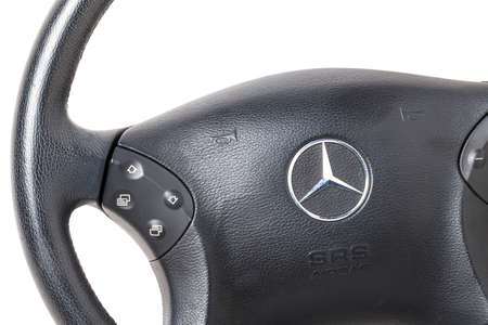 Novosibirsk, Russia - 10.30.2020: Spare part and interior element from a Mercedes-Benz car driver steering wheel on a white isolated background. Auto service industry. Editorial