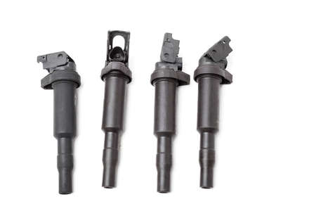 Four ignition coils for an internal combustion engine of a car during repair and service on a white isolated background. Spare parts catalog. Stok Fotoğraf