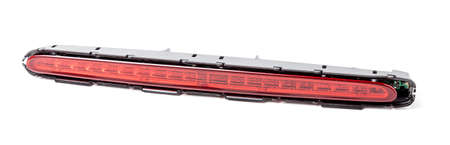 Spare part for sale at an auto-parsing or repair of a car body in service on a white isolated background in a photo studio - LED additional brake light from black and red plastic. Stok Fotoğraf