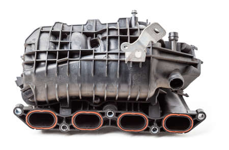 Intake manifold plastic housing with a system for adjusting the air flow to the engine. Repair and replacement of spare parts of vehicles in a car service. Stok Fotoğraf