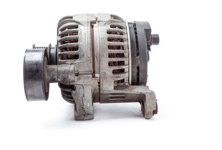 car spare part DC generator for charging the battery and providing electricity to the car's on-board network on a white isolated background. catalog of spare parts for vehicles from the junkyard. Stok Fotoğraf