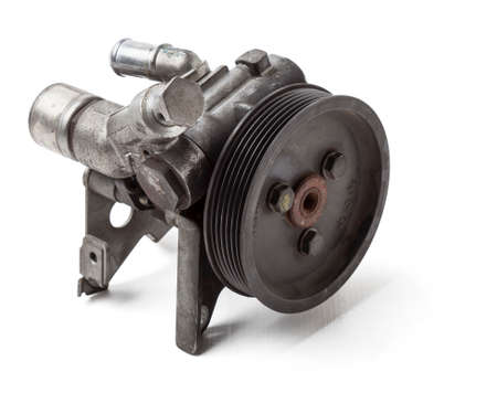 Engine attachments - power steering, a pump that pumps oil to the steering rack to facilitate steering wheel rotation. junkyard Vehicle Parts Catalog Stok Fotoğraf